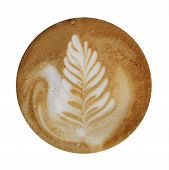 Closeup up of coffee latte foam with leaf design art isolated on a white background viewed from top. poster