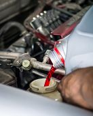 Hand pouring transmission fluid as for the good car maintenance poster