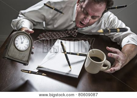 Stressed Yelling Man At Desk With Pens, Coffee, Glasses and Clock Flying Up in the Air.