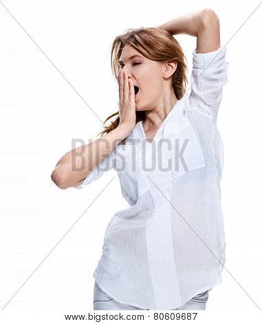 Tired woman yawns and covers her mouth with her hand