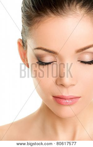 Closed eyes beauty face - Asian chinese woman showing fake eyelashes or eye makeup
