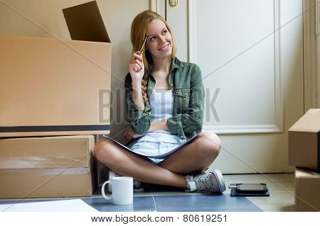 Young Beautiful Woman Moving In New Home.