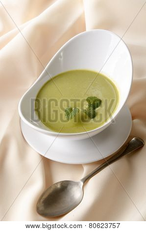 Pea And Minty Soup In A Bowl
