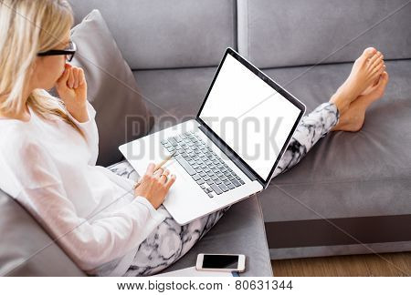 Busy woman working with computer at home