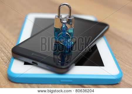 Padlock On Smart Phone And Tablet Computer. Safety & Security On Web Devices