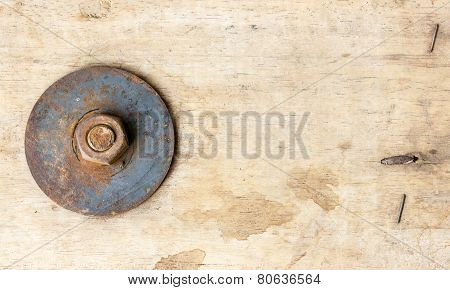 Bolts And Nut On Wood Background