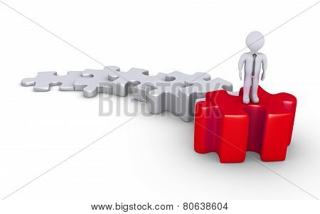 Businessman On Top Of Puzzle Steps