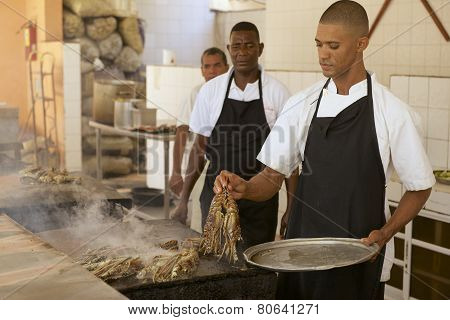 People cook lobsters at a local restaurant in Punto Cana, Dominican Republic.