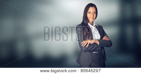 Confident Businesswoman Smiling at the Camera with Copy Space on Side. Captured with Blurry Background.