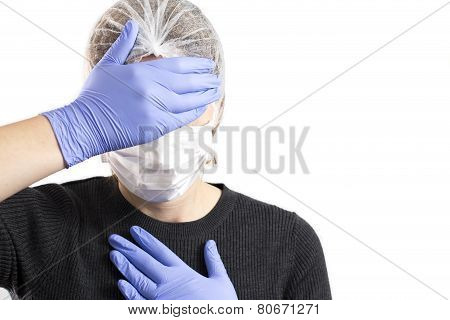 Anguished Doctor Covering Her Face With Her Hands, Isolated On White
