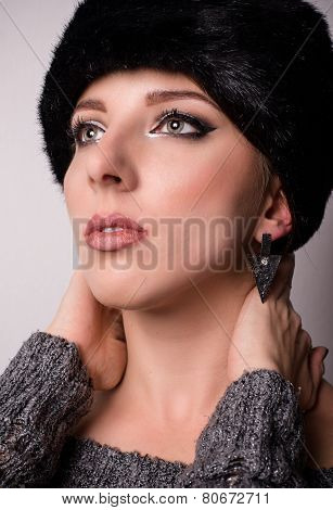 Pretty Woman In Furry Hat Looking Up