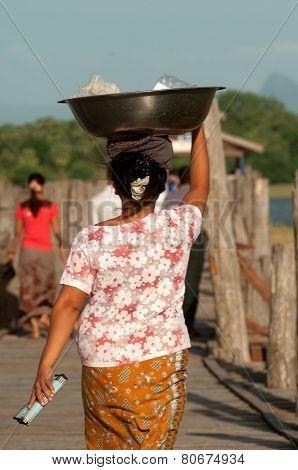 Myanmar Woman Carrying On Her Head.