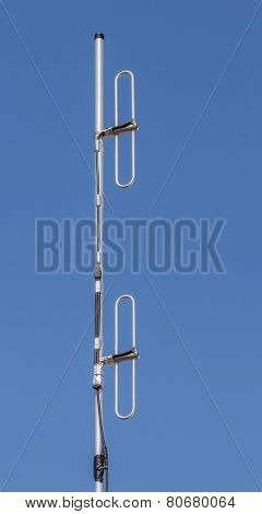 Dipole Antenna For Telecommunications With Blue Sky Background.