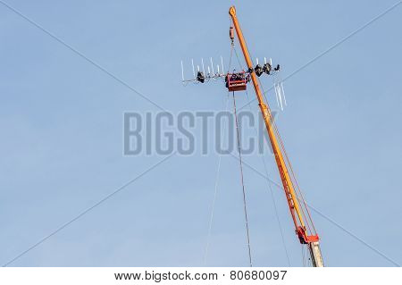 The Construction Site Of Telecommunication Tower With Lifting Crane Is Working.