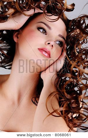 Face Of The Beautiful Girl With  Long Curly Hairs
