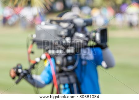 An Unidentified Sport Photographer Is Working During Golf Tournament In Golf Course.