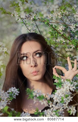 Portrait of an allergic woman surrounded by seasonal flowers holding treatment poster