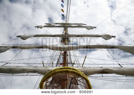 boat mast with furled sails