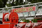 Detail of a fire department vehicle on display during a fire muster parade. poster