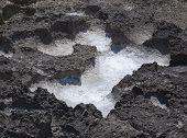 Salt precipitation in eroded black oxidized limestone cavities near Mediterranean sea. July Can Pastilla Mallorca Balearic islands Spain. poster