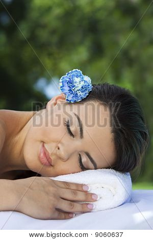 Beautiful Hispanic Woman Relaxing At Health Spa