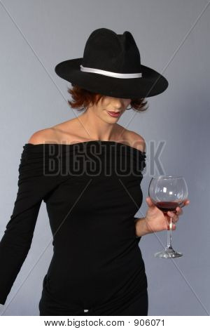 Woman With Black Dress And Wine And Mafia Hat