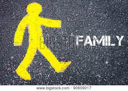 Yellow Pedestrian Figure Walking Towards Familiy