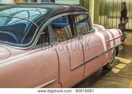 Pink 1956 Cadillac At The Airport