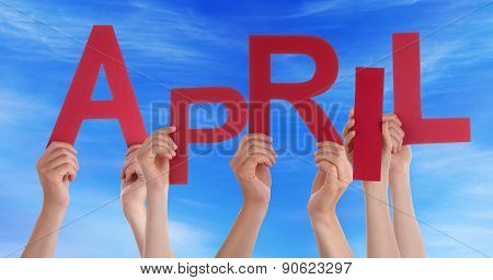 Many People Hands Holding Red Word April Blue Sky