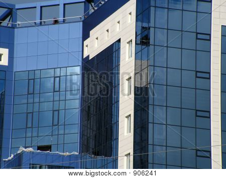 Building With Blue Mirrored Windows And White Walls