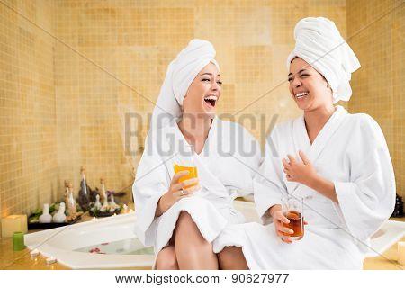 Joyful friends in spa
