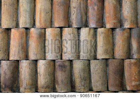 Clay Roof Tiles Set Into A Wall In Ecuador