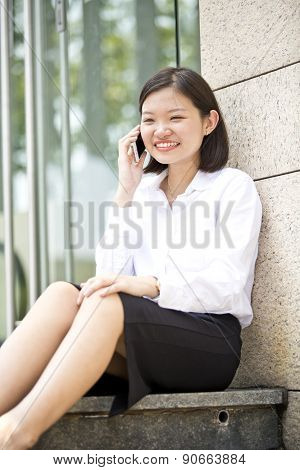 Young Asian female executive using smart phone