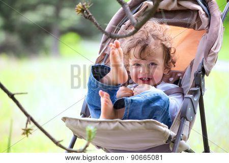 Baby Boy In Stroller Outdoor