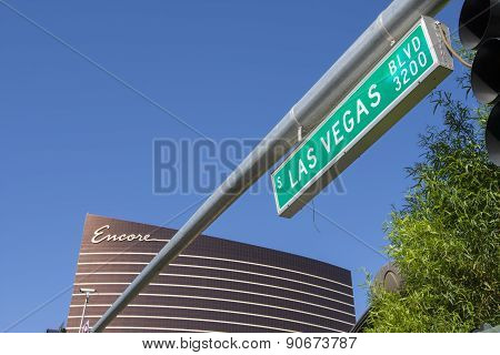 The Encore hotel and a Las Vegas boulevard street sign.