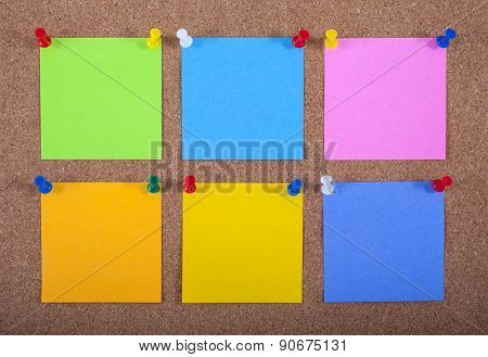 Notes Pinned Onto A Noticeboard