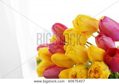 Beautiful bouquet of tulips on fabric background