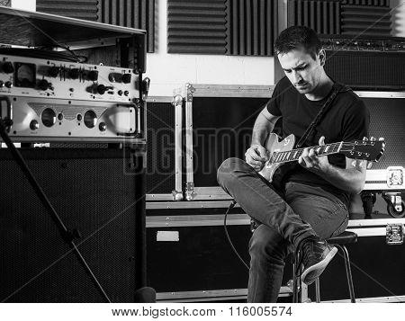 Guitarist Playing Backstage