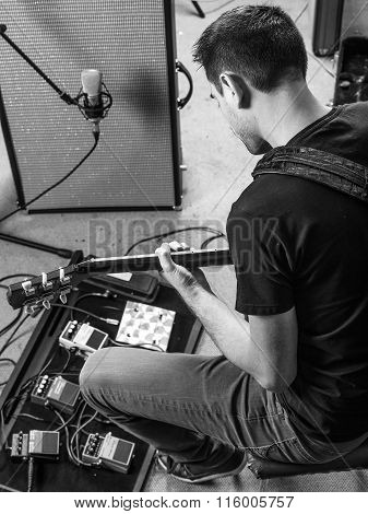 Guitarist Concentrating On His Guitar Recording