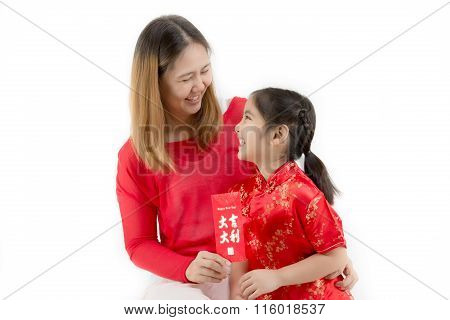 Asian Chinese child receiving Chinese New Year red envelope packet from mother