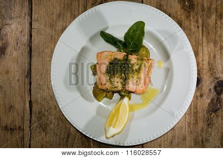 Salmon fillet, pesto and crushed potato plate from above