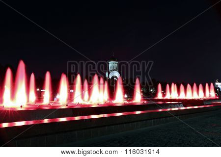 Fountains At Poklonnaya Hill In Moscow At Night With Red Illumination