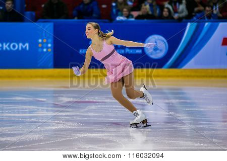 young girl athlete figure skater performance on ice
