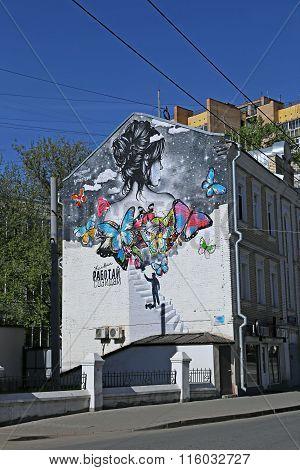 Graffiti City Art On The Wall Depicting A Woman And Butterflies, The Artist Katja Dobryakova