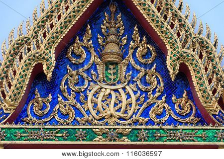 Traditional Thai style Stucco & Naga, Wood Carving Tympanum of Thai Roof Temple