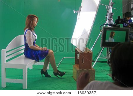 woman is singing on making of music video