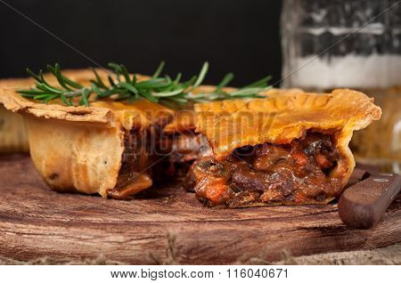 Homemade Australian Meat Pie On The Wooden Table