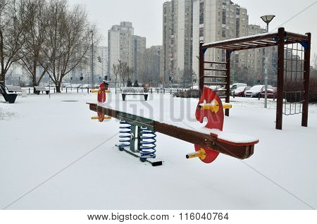 Seesaw In Winter Day
