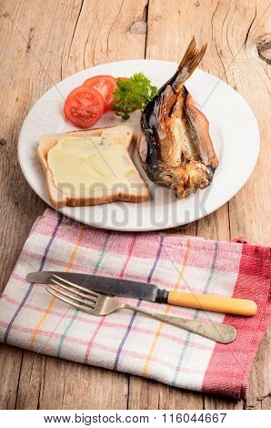 Smoked Kipper With Bread, Sliced Tomato And Parsley On A Plate