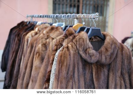 valuable fur coat in vintage style for sale in the flea market outdoors poster